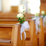 Beautiful flower wedding decoration in a church during catholic wedding ceremony