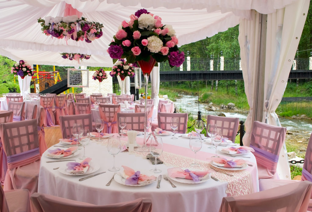 The Pink wedding tables in outdoor restaurant - table arrangements for wedding receptions