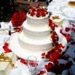 wedding cake with fresh flowers on it